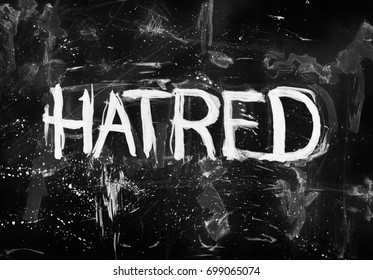 Hatred - negative feeling of aversion, animosity and hostility. Hand-drawn text on dark black background. Dirty painting with scratches, spots and stains