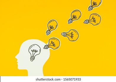 Head with idea bulb concept - Image