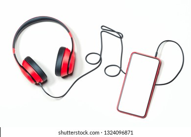 Headphones and mobile phone. Musical note made of earphones wire. 3d rendering.