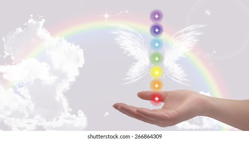 Healing Hand and seven chakras on a sparkling pastel coloured background