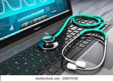 Healthcare, medicine and cardiology tool concept: laptop or notebook computer PC with medical cardiologic diagnostic test software on screen and stethoscope on black wooden business office table