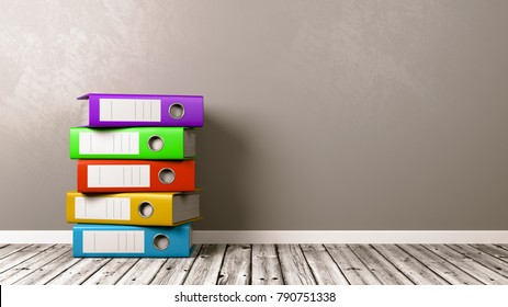 Heap of Colorful Binders on Wooden Floor Against Grey Wall with Copyspace 3D Illustration