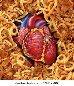 Heart disease food medical health care concept with a human heart organ surrounded by groups of greasy cholesterol rich fried foods as a symbol of arteries clogging due to fat in the diet.