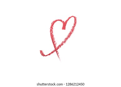 Heart drawn with color lipstick isolated on white.