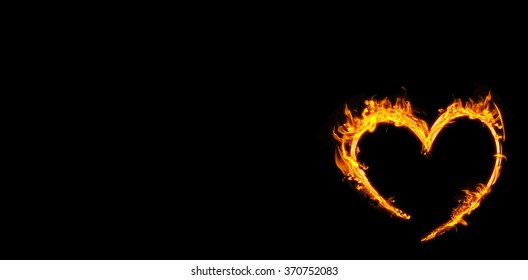 Heart in fire against black