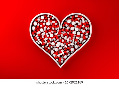 Heart shape filled with red pill capsules over red background - heart medicine, pharmacy industry or healthcare modern minimal concept, 3D illustration