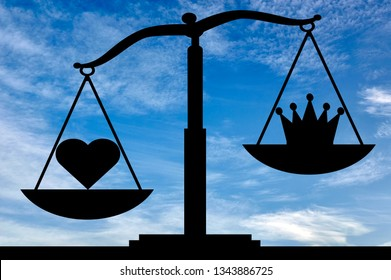Heart symbol altruism is in priority over the crown egoism symbol on the scales. The concept of choosing to be selfish or altruistic