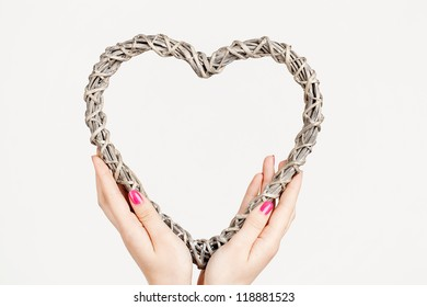 a Heart in woman hands