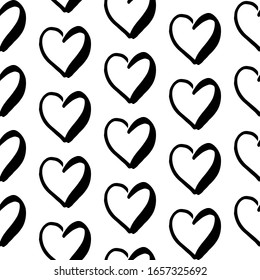 Hearts doodle pattern. Hand-drawn black hearts on white background. Seamless backdrop. Black and white