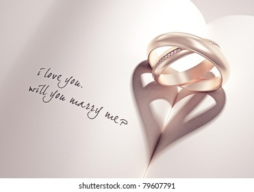 heartshadow with rings on a book middle - i love you - will you marry me - card