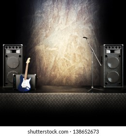 Heavy metal music stage or singing background, microphone, electric guitar and speakers with diamond plated flooring. Advertising concept with room for text or copy space