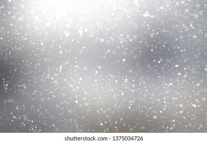 Heavy snow abstract texture. Silver grey blurred background. Flare pattern. Nature decor.