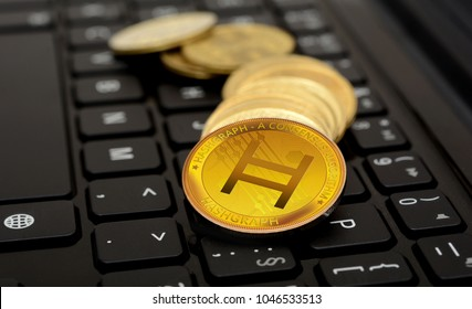 Hedera Hashgraph Crypto Currency coin on keyboard.