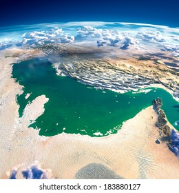 Highly detailed fragments of the planet Earth with exaggerated relief, translucent ocean and clouds, illuminated by the morning sun. Persian Gulf. Elements of this image furnished by NASA