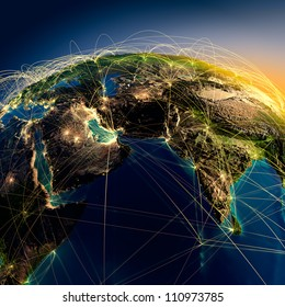 Highly detailed planet Earth at night with embossed continents, illuminated by light of cities. Earth is surrounded by a luminous network, representing the major air routes based on real data