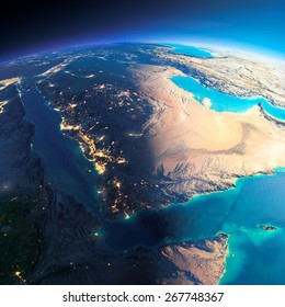 Highly detailed planet Earth. Night with glowing city lights gives way to day. The boundary of the night & day. Saudi Arabia. Elements of this image furnished by NASA
