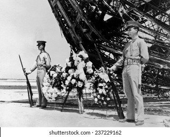 Hindenburg dead are honored on Memorial Day Two US Marines stand guard, May 31, 1937.