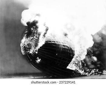 The Hindenburg disaster People run away from the burning dirigible dwarfed by its huge scale, May 6, 1937.