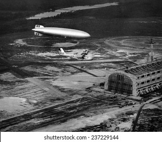 Hindenburg's arrival with an escort plane over Lakehurst New Jersey Minutes later it exploded and crashed, May 6, 1937.