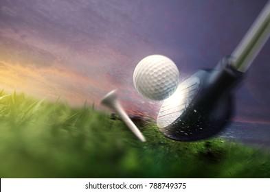 hitting golfball on grass field