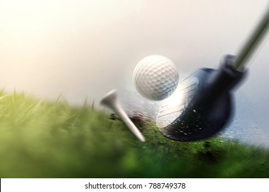 hitting golfball on grass field