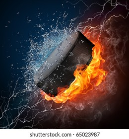 Hockey puck in fire and water. Illustration of the hockey puck enveloped in elements isolated on black background. High resolution hockey puck in fire and water image for a hockey game poster.