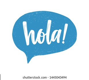 Hola Spanish greeting handwritten with white calligraphic cursive font inside blue speech bubble or balloon. Creative hand lettering. Modern illustration for t-shirt, tee or sweatshirt print