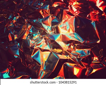 Holographic color wrinkled foil. Hologram background of wrinkled abstract foil texture with colors and shiny background