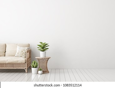 Home interior mock up with wicker rattan sofa, beige pillows, table and green plants in living room with empty white wall. 3D rendering.