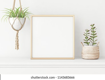 Home interior poster mock up with square metal frame, succulents in basket and macrame plant hanger on white wall background. 3D rendering.