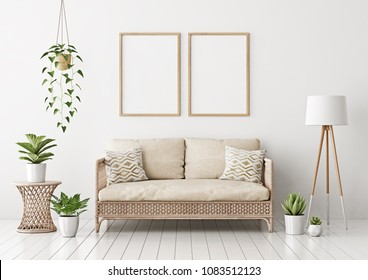 Home interior poster mock up with two vertical empty wooden frames, wicker rattan sofa, plants and lamp in living room with white wall. 3D rendering.