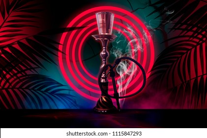 Hookah on the background of neon lamps and tropical leaves