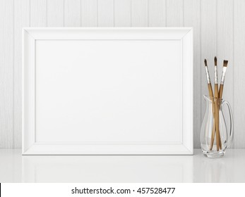 Horizontal interior poster mock up with empty white frame and art brushes on wooden background. 3D rendering.