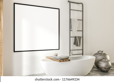 Horizontal mock up banner frame hanging on white wall of luxury spa bathroom. A bathtub, vases and a towel rack. Side view. Marketing and advertising concept. 3d rendering