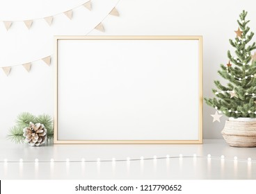 Horizontal poster mock up with golden frame, decorated christmas tree, garland lights and holiday decoration on white wall background. 3D rendering.