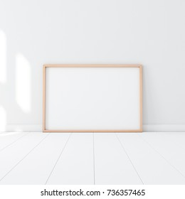 Horizontal Wooden Poster Frame Mockup standing on the white floor in empty room. 3d rendering