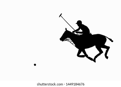 horse polo player astride the galloping horse with mallet in the hand raised for blow