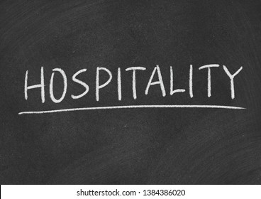 hospitality concept word on a blackboard background