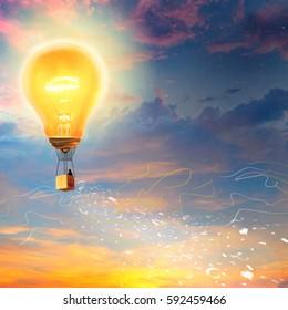 Hot air balloon in form of a light bulb. Man flies in a balloon