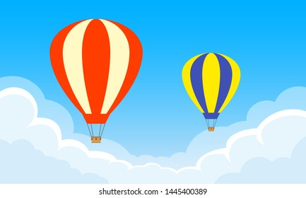 Hot Air Balloons flying in the sky with clouds.