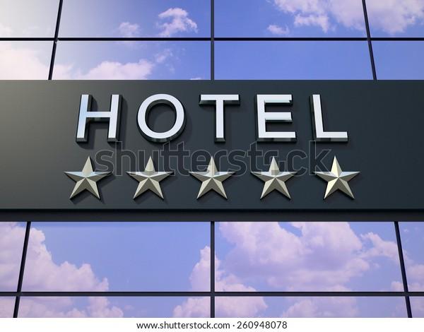 Das Hotelschild mit fünf Sternen auf dem modernen Gebäude.