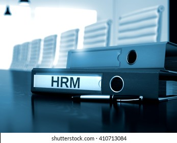 HRM - Illustration. Hrm. Illustration on Blurred Background. HRM - File Folder on Working Desktop. HRM - Business Concept on Blurred Background. 3D Render.