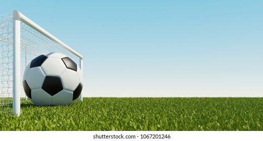 Huge soccer ball in goal of soccer field in front of a blue sky (3D Rendering)