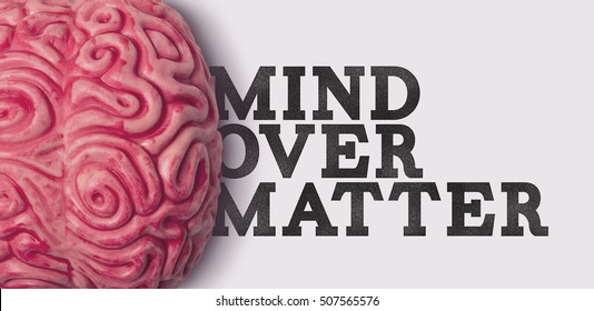 Human brain with the phrase mind over matter on a plain background