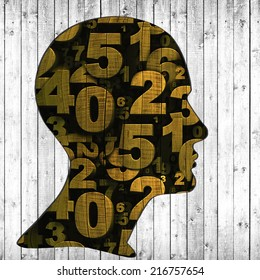 human head with numbers of wood and wood background