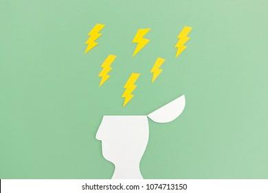 Human open head with thunderbolt symbols