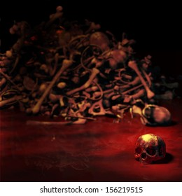 Human Skull - a bloody human skull lying in a pool of blood in front of a pile of bones.  Focus on the skull. Happy Halloween.