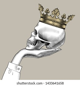 Human skull full face with a gold crown. Vintage engraving stylized drawing.