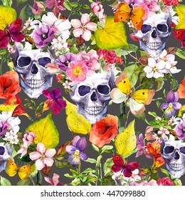 Human skulls with flowers and yellow autumn leaves. Seamless pattern. Watercolor