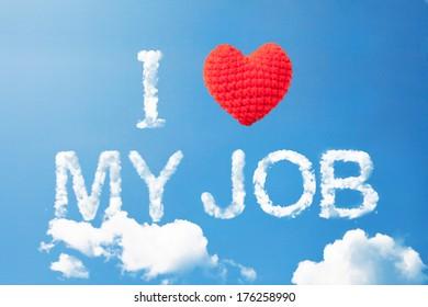 """I love my job"" a cloud word and wool heart on sky"